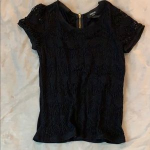 Black blouse with zipper in back.